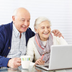 old people in front of laptop