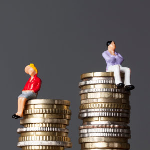 women tend to earn less than their male partners